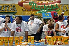 Contestants slump after finishing the annual Coney Island Hot Dog Eating Contest. Wonder how many calories MyFitnessPal would show to each contestant?