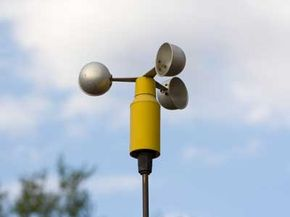 An anemometer spins in the breeze, measuring wind speed.