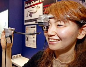 Will we view future versions of the Web through devices like this tiny head-mounted display? See more computer pictures.