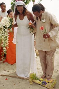 A couple prepares to jump the broom during their wedding ceremony.