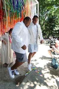 A couple jump the broom during their wedding at a pop-up chapel in New York City's Central Park on July 30, 2011 -- the first Saturday that same-sex couples were legally allowed to marry in N.Y.