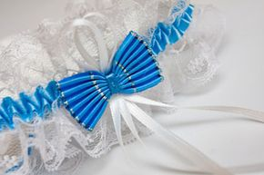 """Many brides like to choose a garter that incorporates """"something blue"""" in order to stick to the popular rhyme."""