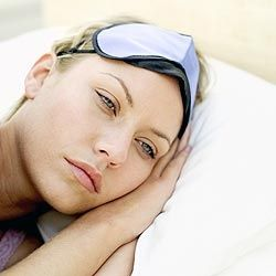 Woman suffering from lack of sleep.