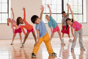 Regular P.E. helps kids learn sports and valuable life skills but the timeframe is not enough to help children lose weight.