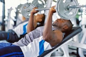 Weight lifting can help you lose weight and build muscle mass. See more men's health pictures.