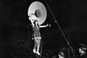 Tightrope walker Mlle Elleanorer performs on a high wire in 1922.
