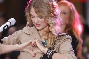 """Taylor Swift makes her """"heart"""" gesture at a performance on the Today show. Let's hope she won't get into trouble now that Google has patented it in connection with """"liking"""" something via Google Glass."""