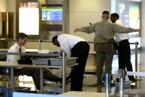 Screeners for the TSA check passengers at Reagan National Airport in Virginia. TSA screeners have seen some pretty outrageous items in passengers' luggage over the years.