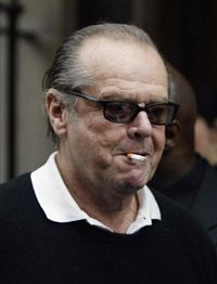 Actor Jack Nicholson smokes a cigarette as he leaves Claridge's hotel in London Feb. 2, 2004. A major goal of wellness programs is to get participants to quit smoking.