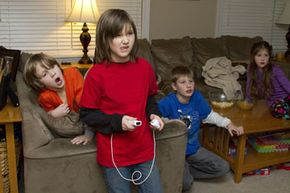 For those waiting for their turn, video games are sometimes a spectator sport.