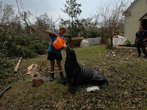 Animal caretaker Shannon Huyser pours water over Freebie the sea lion in Gulfport, Miss., on Sept. 1, 2005.