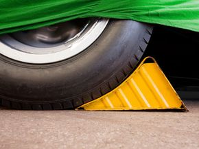 Always place wheel chocks against the direction of the grade.