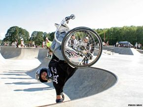 Aaron Fotheringham does a hand plant.