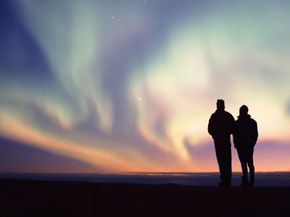 Hikers view the Northern Lights in the Arctic National Wildlife Refuge in Alaska.