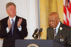 Ninety-four-year-old Herman Shaw, one of the unknowing patients in the Tuskegee Syphilis Study, speaks during ceremonies at the White House in 1997 in which U.S. President Bill Clinton apologized to the survivors and families of the victims of the study.
