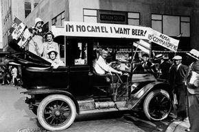 Prohibition protesters parade in a car emblazoned with signs and flags calling for the repeal of the 18th Amendment. See more pictures of Prohibition.