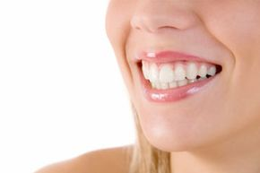 Teeth whitening strips deliver a bleaching effect and create pearly white smiles. But do they damage the teeth?