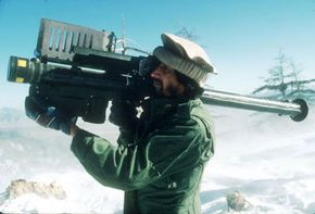 An Afghani rebel aims a stinger missile at an aircraft in February 1988. Afghanistan in one of the nations where a proxy war was fought between the USSR and the U.S.