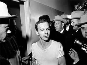 Lee Harvey Oswald speaks to the press one day after the assassination of JFK and one day before his own death.