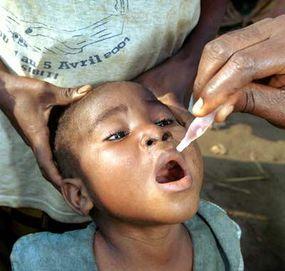 A child receives the polio vaccine in July 2001, near Sibiti, Congo.