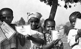 Children of Cameroon, Africa, with their smallpox vaccination certificates
