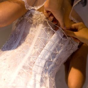 Your bridesmaids can help you get out of your wedding dress and into your more comfortable reception dress in a hurry.