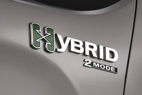 A hybrid badge on a 2009 Chevrolet Silverado -- the first full-size, full hybrid pickup truck on the market. See pictures of hybrid cars.