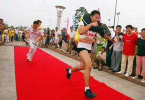 There's more than one way to carry a wife, as demonstrated by two Chinese participants in the Snowflake Beer Cup Wife Carrying Competition in Shenyang, China. See more pictures of extreme sports.