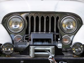 The front end of an off-road vehicle, including the winch, which can help pull the vehicle out of the mud.