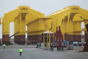 These massive three-pronged steel legs are necessary to anchor each turbine in a North Sea wind park -- a requirement that makes some offshore construction prohibitively expensive.