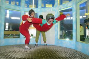 Vertical wind tunnels, like this one in China, let skydivers practice their techniques indoors.