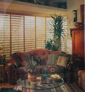 © Wide wooden slats on a shutter treatment in this Southwestern living room create a strong linear pattern at the window without a trace of print, fabric, or color.