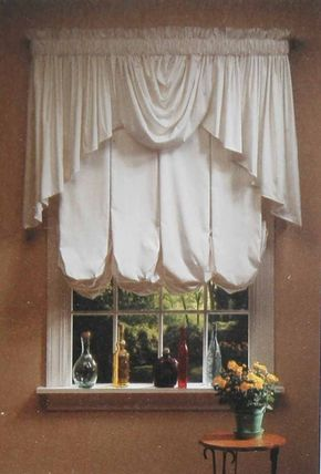 ©This End Up Furniture Co., Inc. This treatment features rich folds of fabric on a balloon shade topped by a tapered valance with a central swag.