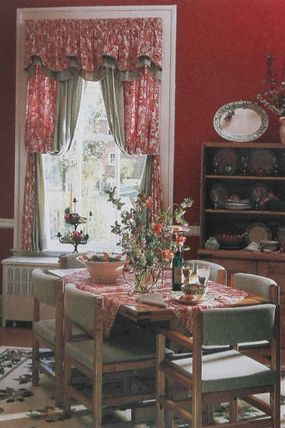 © What's good once is better twice -- that's the logic behind this window treatment. Curtains in a printed fabric have their form repeated in a solid, contrasting fabric.