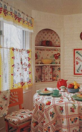 © In a creative stroke of adaptive reuse, a 1940s tablecloth fabric brings high-spirited nostalgia to the window as a cafe curtain and matching valance.
