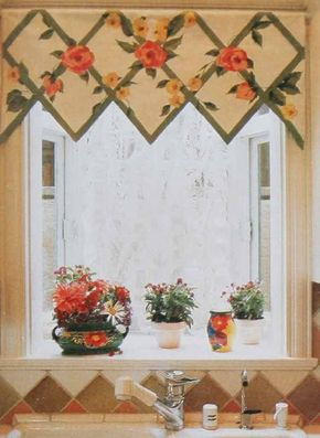 © A window shade hand-painted in a lattice pattern overgrown with blooming vines is the ideal companion for a colorful display of potted plants on the sill below.