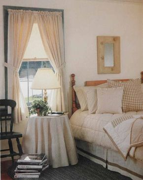 © Old-fashioned ticking stripes are drafted into service on this bedroom window's insulated shade and matching curtains with tiebacks, creating a yesteryear feel.
