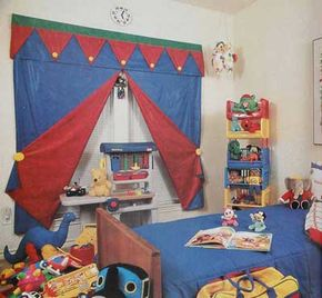 © This child's room is given a circus feel with a single window treatment for the pair of adjacent windows: blinds covered by cotton curtain panels and a patchwork valance.