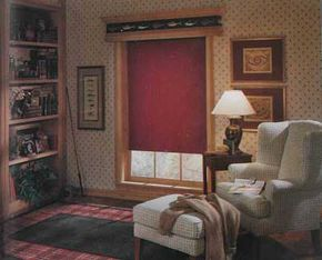 © On this rec-room window, the natural wood frame and cornice establish the mood, completed by a red shade and a trout border that swims across the wooden cornice.
