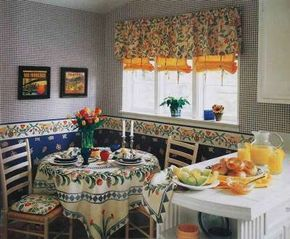 Canary yellow stagecoach shades tied with patterned fabric matching a print valance express blue-sky optimism at the windows.