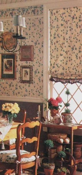 The window treatment echoes the walls with the same fabric and is finished at the bottom edge with lace trim in the same deep jewel tone used on the lower wall.