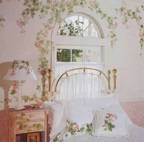 Hand-painted leaves and flowers as a window treatment enhance this bedroom's garden scene.