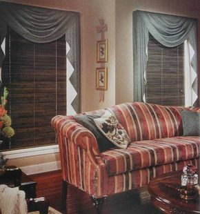 © Stained blue, with the charming irregularity of color that characterizes stain and sets it apart from paint, wood blinds dominate the windows in a traditional living room.