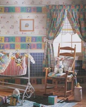 The numerous prints in this nursery are well tied together at the window.