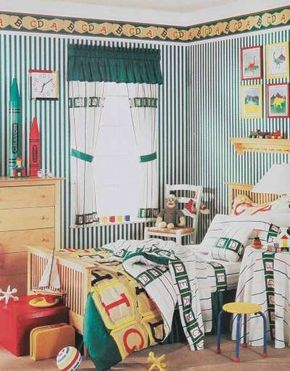 Simple white tieback curtains are accented with a punchy forest green. Alphabet-print strips at the top and bottom are entertaining designs for children.