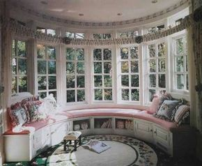 A continental curtain rod that encircles this half-round window wall is purely ornamental -- even the flanking side panels are stationary, just for looks.