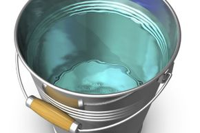 A bucket of warm, clean water is the first thing you need -- you'll use it to dunk and rinse your sponge.