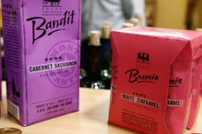 Red and purple cartons of Bandit wine displayed in the booth of a California dealer at a wine fair in Bordeaux, France.  Demand for environmentally friendly wine packaging is increasing.