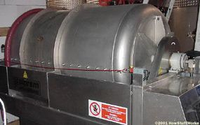 A wine press separates the juice from the skins.