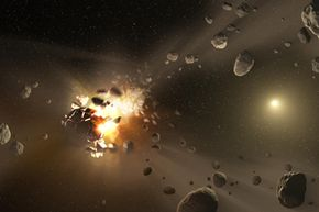 This artist's conception shows how families of asteroids are created. Catastrophic collisions between asteroids located in the belt between Mars and Jupiter have formed families of objects on similar orbits around the sun.